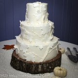 White fondant leaves on fall cake