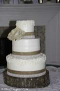 Burlap accents on wedding cake
