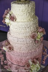 Ombre ruffles on feminine pink wedding cake