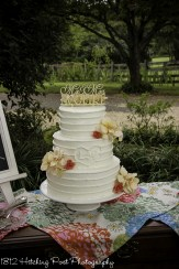 Carved initials on rustic wedding cake