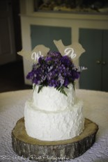 "Rough iced cake with ""We Do"" topper"