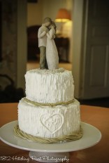 Carved initials in tree with raffia trim wedding cake