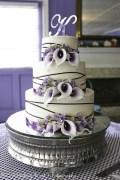Deep purple calla lilies and ribbon on wedding cake
