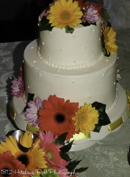 Bright flowes on dotted wedding cake