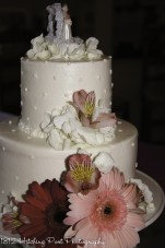 Small dots and pink flowers on wedding cake