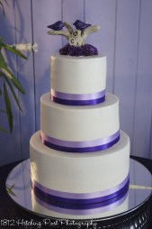 Lavender and purple ribbons on wedding cake