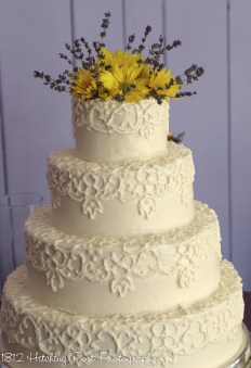 Wedding cake with lace design from bride's dress
