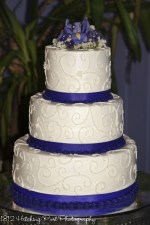 Purple ribbon on piped cake