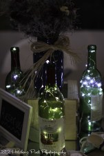 Wine bottle centerpieces with tiny lights