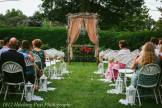 Ceremony centered on boxwoods