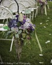 Florist provided cones filled with dusty blues and purple flowers