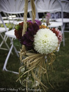 Dahlias i n mason jar tied with raffia