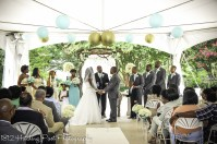 Bride provided centerpieces in Tiffany blue on vases line aisle for tent wedding