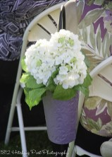 Silk white hydrangeas in aisle container painted lilac