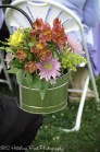 Galvanized bucket hung from shepherd's hook with florist provided bouquet