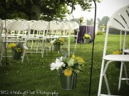 White and yellow flowers with greenery as accent for lilac wedding colors