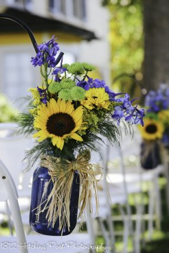 Live sunflowers, with lime and blue in navy mason jar