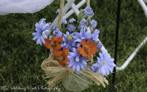 Carolina blue and orange silk flowers in mason jars