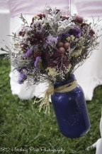 Navy blue mason jar with dried bouquets