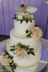 Pink and peach flowers with lovebirds cake