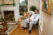 Groom in living room chair