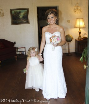 Bride walks with daughter