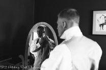 Groom reflection in mirror