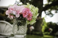 Hobnail glass jars on aisle with silk flowers