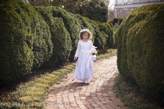Flower girl on walkway in March