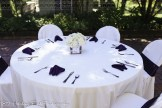 Tables with purple napkins and sashes