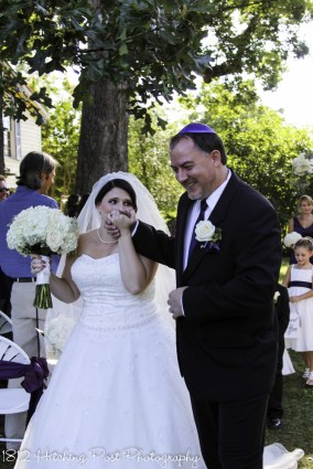 Bride kisses hand of groom