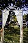 Bride walks through first arbor toward second