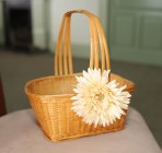 Basket with cream white flower