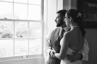 Bride and groom in window