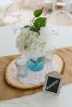 Blue mason jar with silk hydrangeas and jelly jar candles