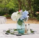Blue mason jar with silk flowes