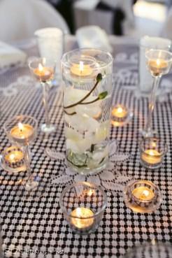 Floating candle with submerged silk orchid