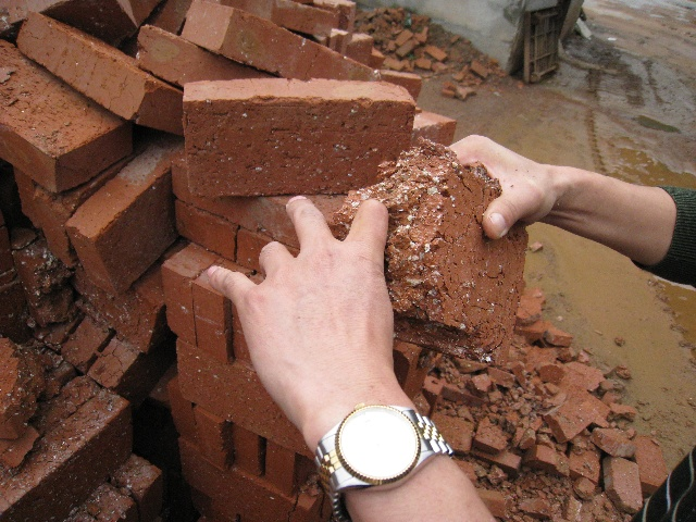 The problem is the little white things; too much calcium oxidizes before the heating process, leading to this brick powder
