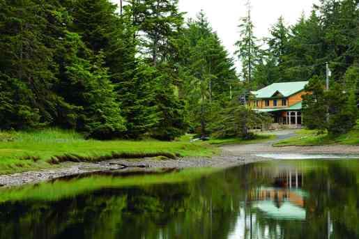 the ancient Haida village of K'uuna Llnagaay (Skedans)—the third largest in an archipelago of 150 islands known as Haida Gwaii, off British Columbia's west coast.