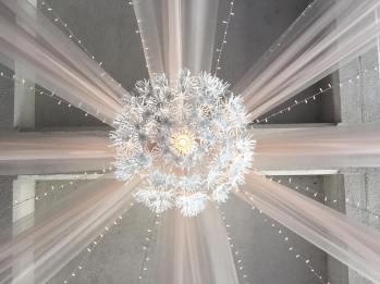 8 Panels of Champagne Organza, 12 Strands of Twinkle Lights, 1 Large Floral Pendant Light