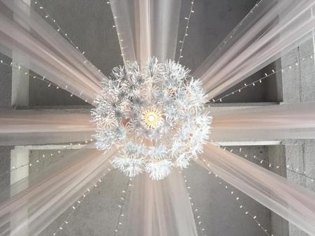 8 Panels of Champagne Organza, 12 Strands of Twinkle Lights, 1 Large Floral Pendant Light