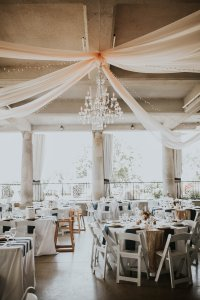 6 panels of blush organza fabric, XL Crystal Chandelier, 4 strands of twinkle lights