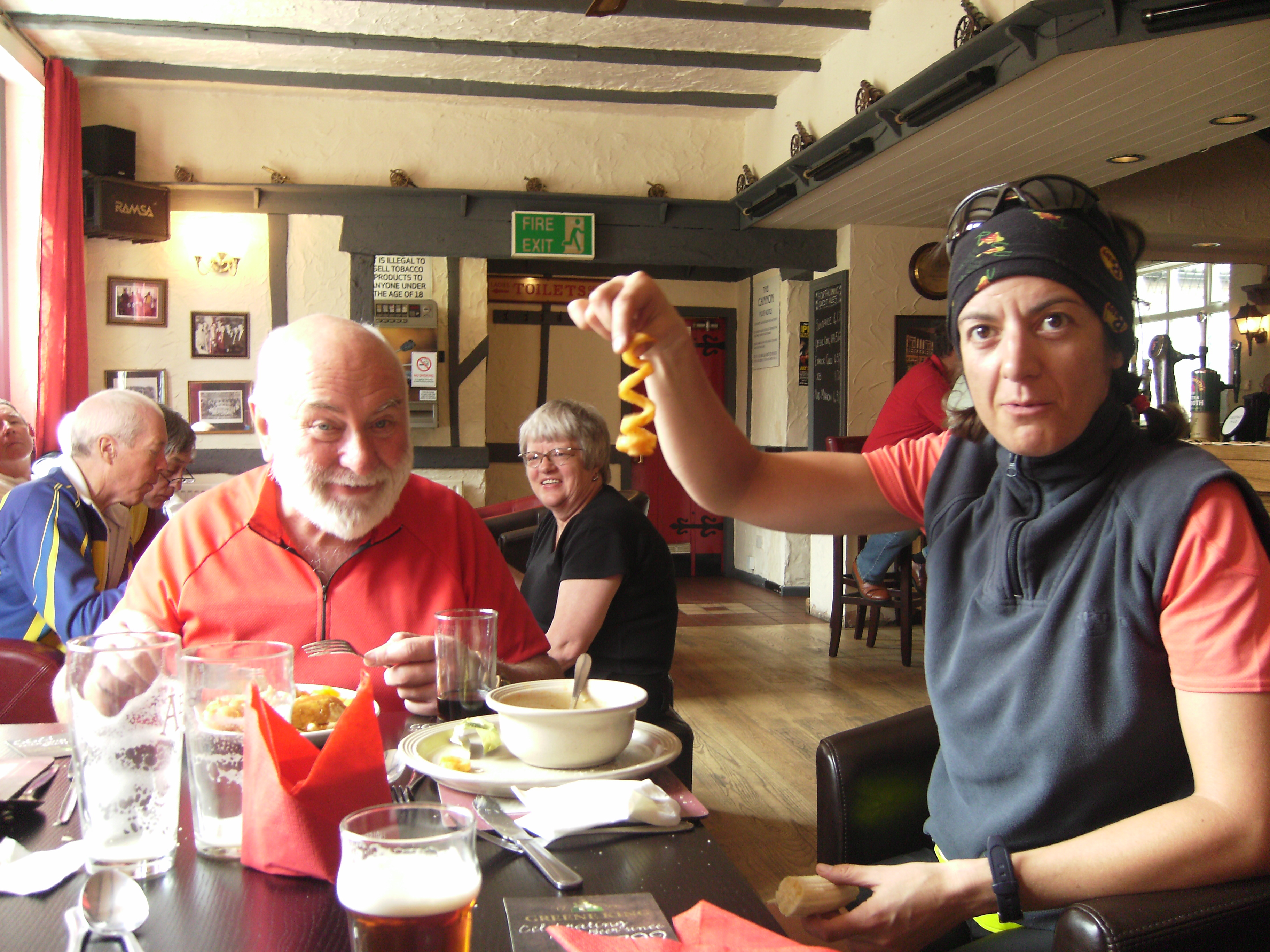 Sid having a free meal and Anna examining a strangely shaped chip in the Cannon pub in Cross Clay. Terry and Margaret in the background