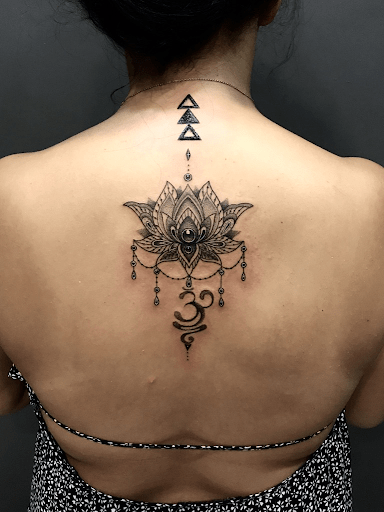 Lotus tattoo with om symbol meaning and design