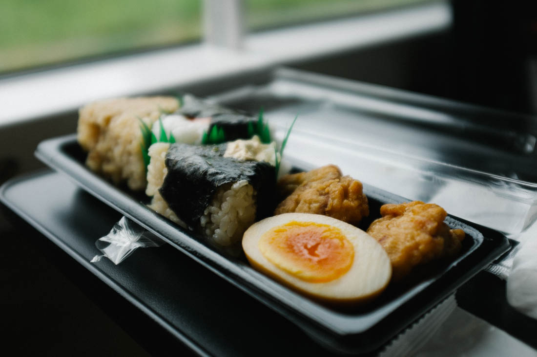 Our small feast: onigiri, fried chicken and soy egg