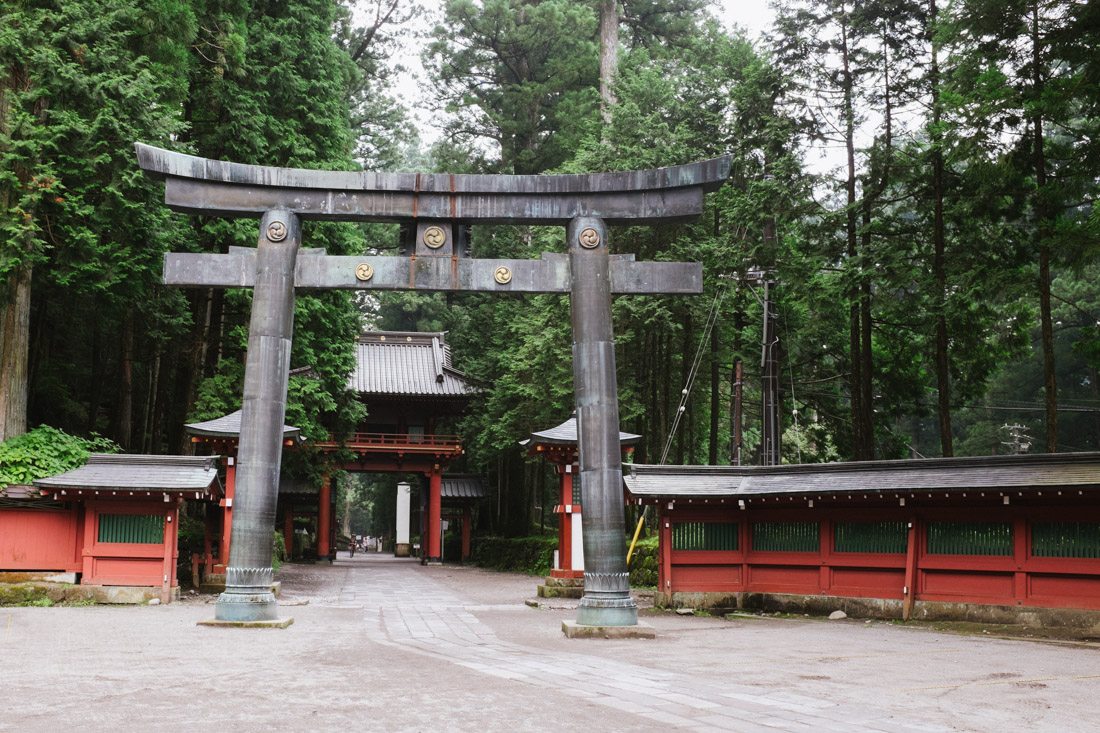 Futarasan entrance tori seen from inside the shrine grounds.