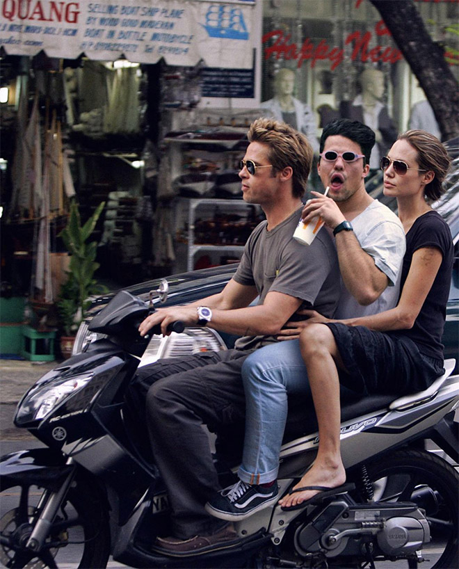 Riding a scooter with Brad Pitt and Angelina Jolie.