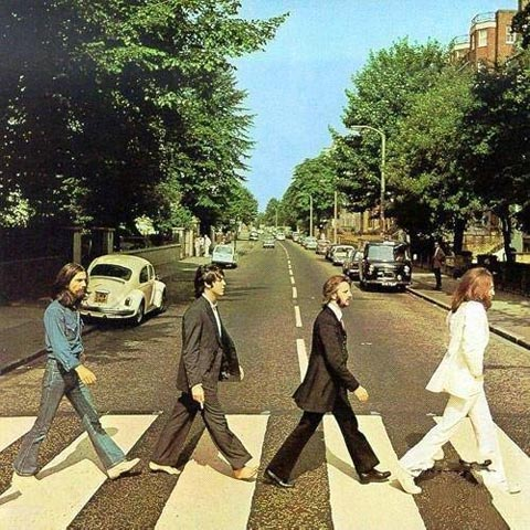 january2003-the-photo-below-the-original-version-of-the-cover-of-the-album-beatles-abbey-road-in-the-hands-of-paul-mccartney-cigarette.jpg