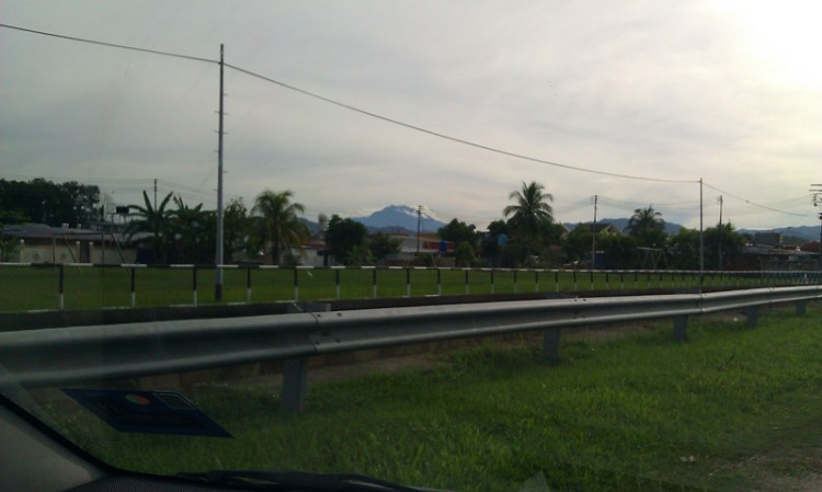 Random roadside snap of Mt. Kinabalu on the horizon