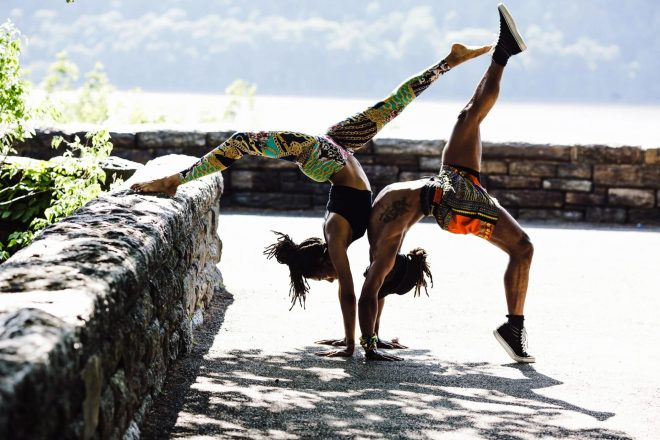 two people doing handstands together practicing fitness for their health